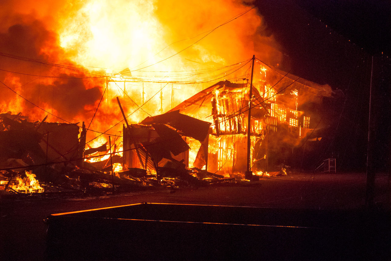 Houses Burning On Field