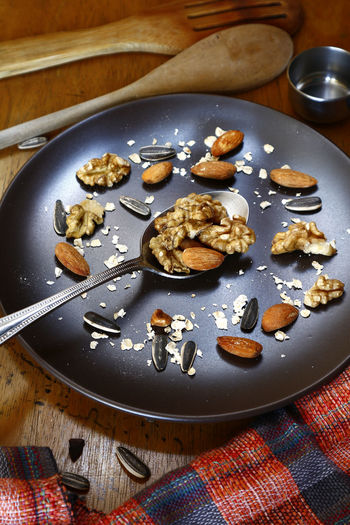 walnut, almond nuts, sunflower seeds and oats on a plate Food Snack Time! Snacks! Plate Spoon Utensils Walnut Oat - Crop Oats - Food Wheat Sunflower Seed Ingredient Kitchen Utensil Kitchen Taste Flavor Superfood Comfort Food Table Close-up Food And Drink Almond Nut - Food Walnut