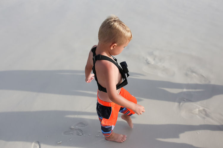 Boy Walking On Beach With Action Camera Strapped To Chest Childhood Child One Person Real People Full Length Shadow Lifestyles Leisure Activity Boys Cute Innocence Casual Clothing Day Nature Land Action Camera Gopro Goprohero4 Boy Sand Beach Summer Summertime Summer Vacation Action