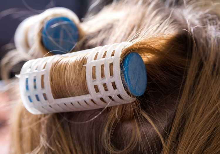 Close-up of woman wearing hair curlers