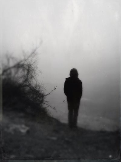 Man standing in foggy weather