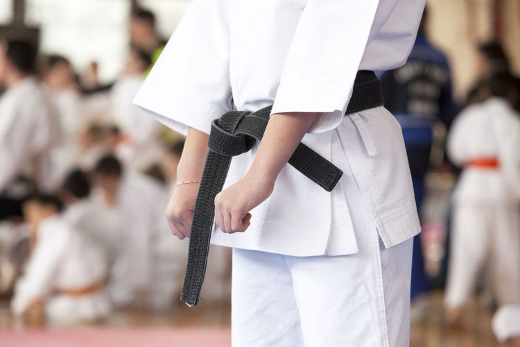 Midsection of women practicing karate