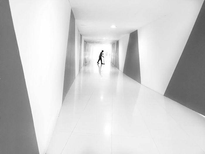 Man and woman walking in corridor of building