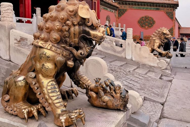 Statues on temple outside building