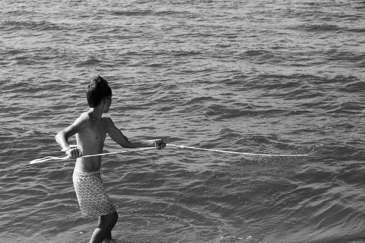 Full length of woman on sea shore