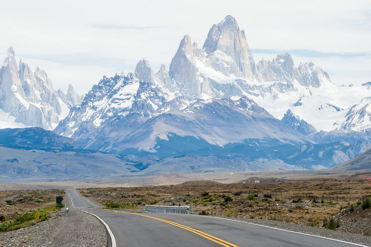 Empty road against fitz roy mountains during winter
