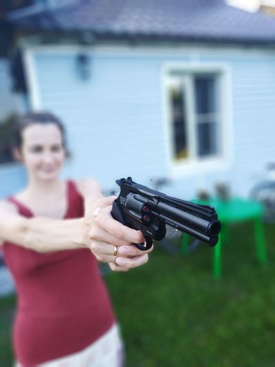 Woman Shooting With Handgun In Yard
