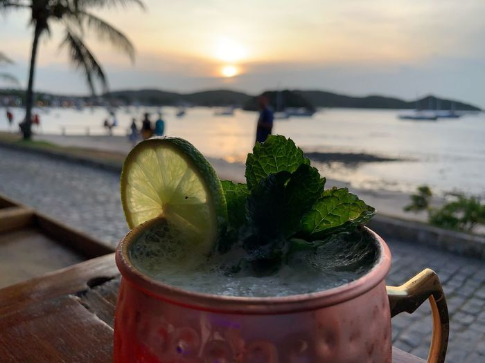 Mint Lemon Drink Food And Drink Refreshment Water Close-up Alcohol Freshness Sunset Incidental People Glass Nature Focus On Foreground Sky Cocktail Sea Beach Drinking Glass Outdoors It's About The Journey