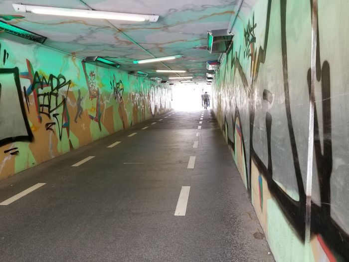 Underpass to Spielberk Center offices. Europe Czech It Out People Walking Streetphotography Wall Art Walkway Bike Path City Green Color Words Letters Pavement Grey Ceiling Lights Tunnel Colorful Graffiti Architecture Built Structure Art Mural Diminishing Perspective Wall - Building Feature The Way Forward The Street Photographer - 2018 EyeEm Awards