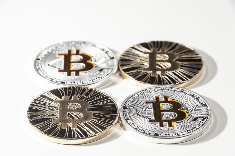 Shining metal BTC bitcoin coin on white background Bitcoin Blockchain BTC Buy Cryprography Crypto Cryptocurrency Currency Dark Web Deep Web Earn Exchange Finance Gold Internet Mining Money Savings Sell Silver  Symbol Trade Virtual