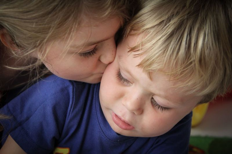 Brother and sister love Kisses Headshot Faces Of EyeEm Sibling Kid Dubai Happy Girl Child Family Daughter Childhood Child Boys Males  Men Togetherness Emotion Portrait Two People Real People Family Bonding Females Headshot Innocence Indoors  Cute Love Positive Emotion