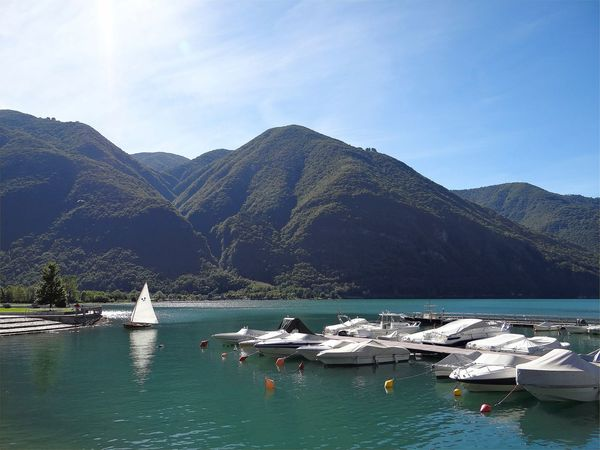 Beauty In Nature Day Lake Moored Mountain Mountain Range Nature Nautical Vessel No People Outdoors Range Scenics Sky Sunlight Tranquil Scene Tranquility Transportation Water Waterfront