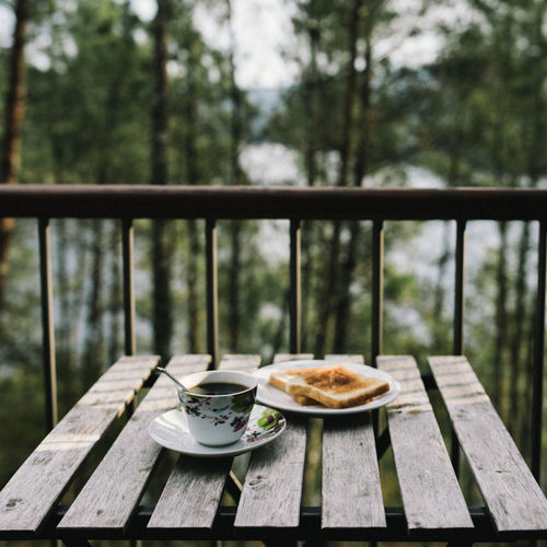 Balcony Breakfast Coffee - Drink Cup Day Drink Food Food And Drink Freshness Healthy Eating Nature No People Outdoors Plate Railing Ready-to-eat Refreshment Serving Size Sweet Pie Table Tissue Water Wood - Material Fresh On Market 2017