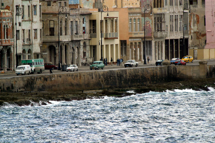 Cuba, La Habana Water Architecture Built Structure Mode Of Transportation Transportation City Building Exterior Waterfront Car Motor Vehicle Nautical Vessel Day Motion Nature Building No People Land Vehicle Sea Canal Passenger Craft Flowing Water