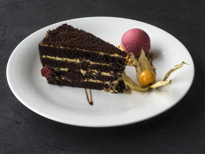 piece of chocolate cake with a ball of crimson ice cream Chocolate Ball Browny Cake Close-up Crimson Day Dessert Food Food And Drink Freshness Ice Cream Indoors  Indulgence No People Piece Plate Ready-to-eat SLICE Sweet Food
