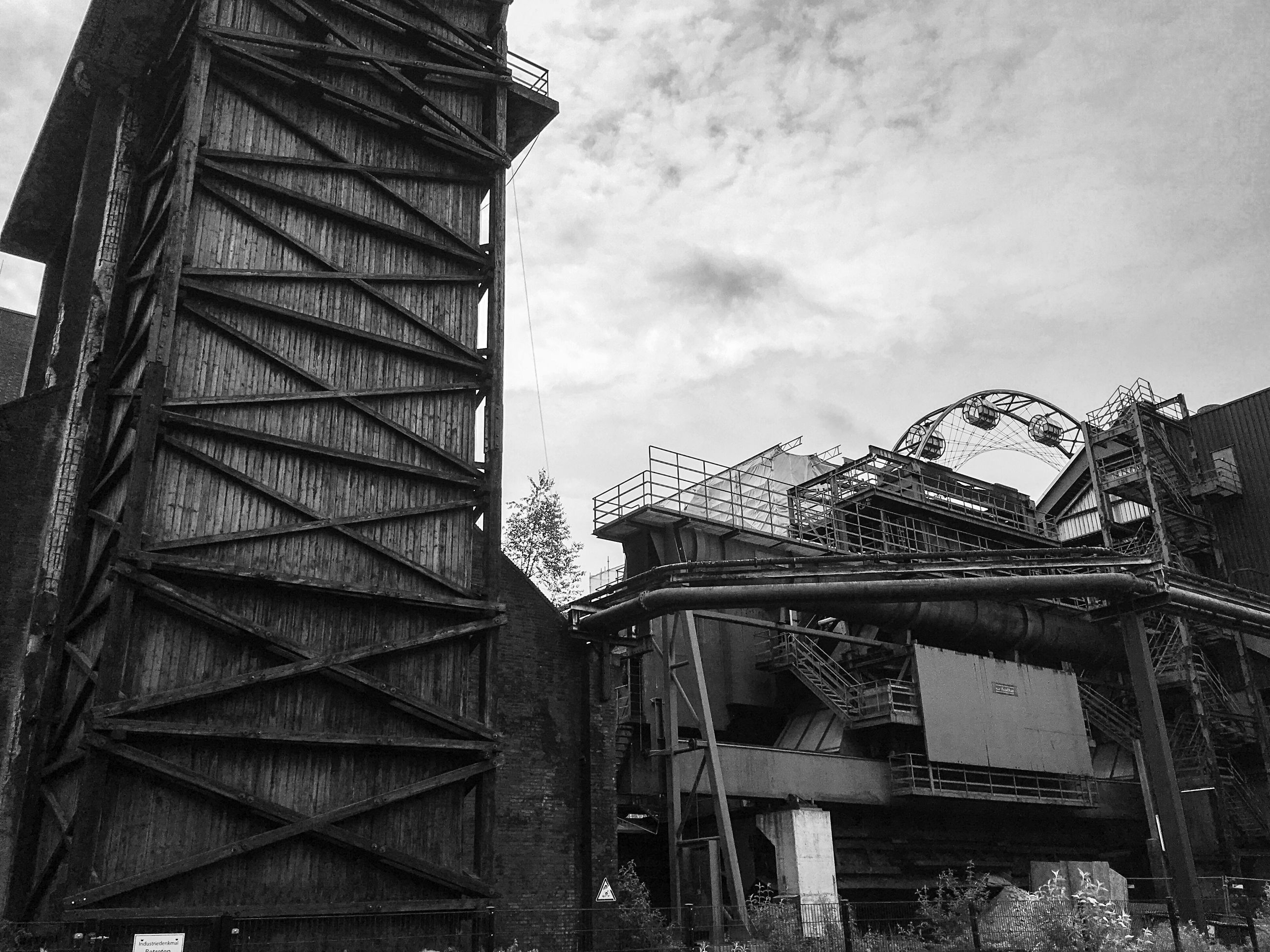 architecture, built structure, low angle view, building exterior, sky, metal, cloud - sky, building, old, day, cloud, abandoned, outdoors, no people, metallic, residential structure, cloudy, factory, connection, residential building