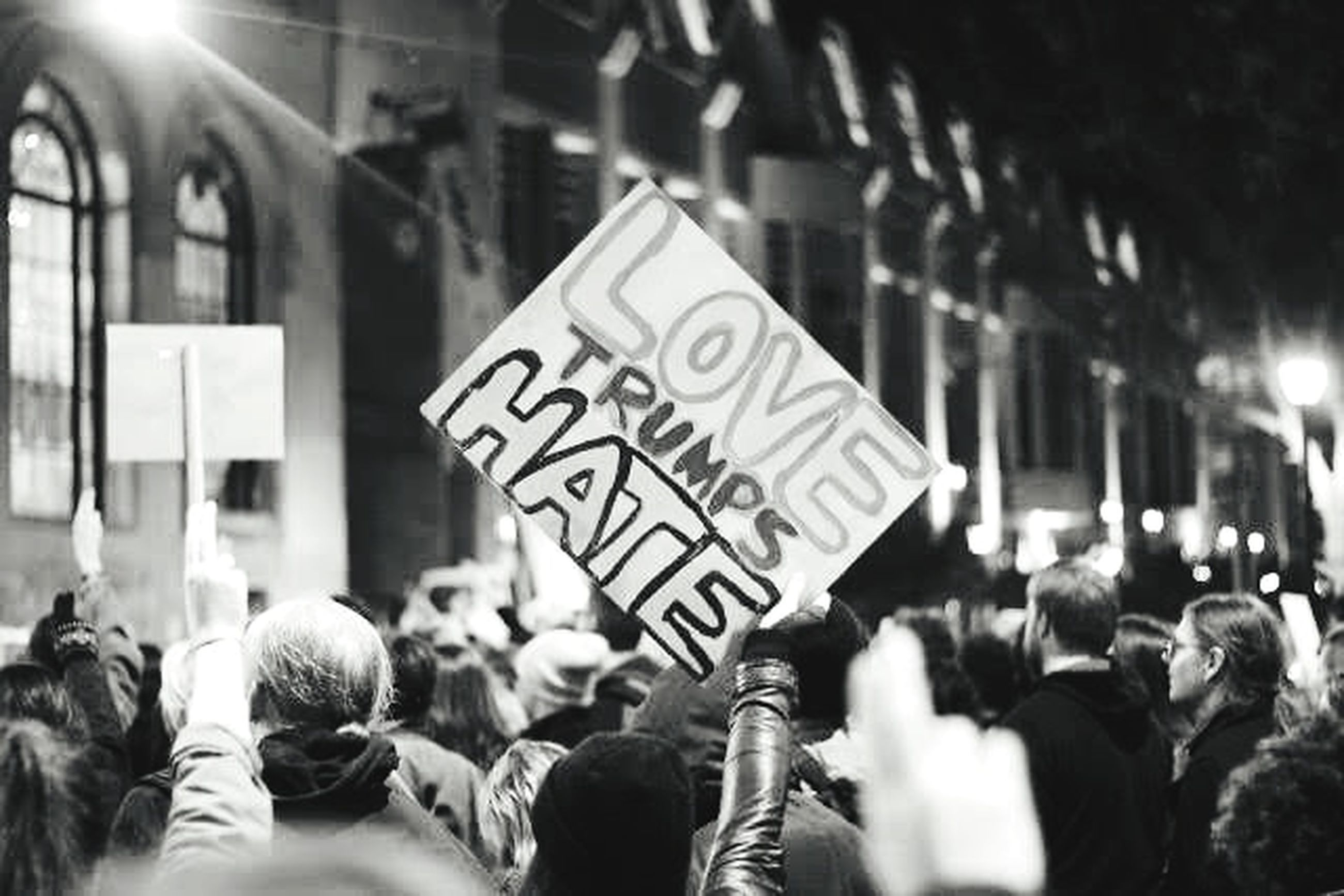 city, group of people, street, crowd, architecture, adult, communication, city life, men, sign, people, social issues, protest, crowded, motion, women, text, city street, real people, protestor, message, obscured face