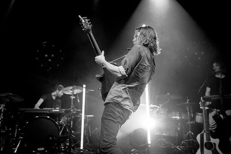 Man playing guitar in nightclub