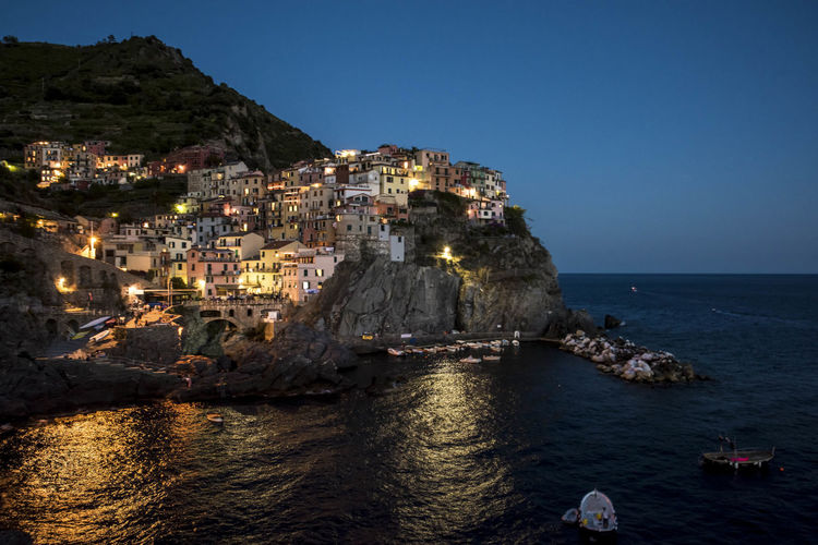 Beauty In Nature Colour Of Life Cinque Terre Liguria Cliff Coastline Day Idyllic Manarola Mountain Nature Outdoors Residential District Rippled Rock Rock - Object Rock Formation Scenics Sea Sky Town TOWNSCAPE Tranquil Scene Tranquility Vacations Water