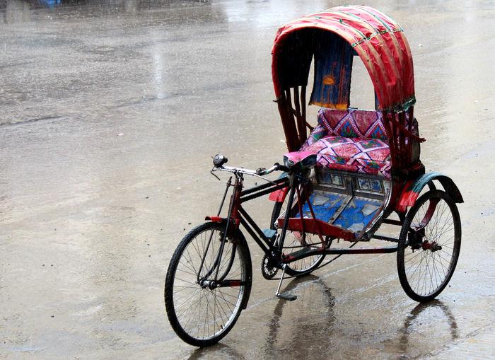 Old Pedicab On Wet Road