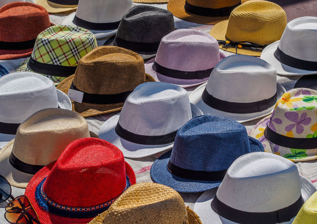 Côte D'Azur Fashion Nice, France Cat Choice Colorful Hat Headwear Market Multi Colored Pattern Pile Selection Several Summer Fashion Summer Wear Sun Hat Variation An Eye For Travel