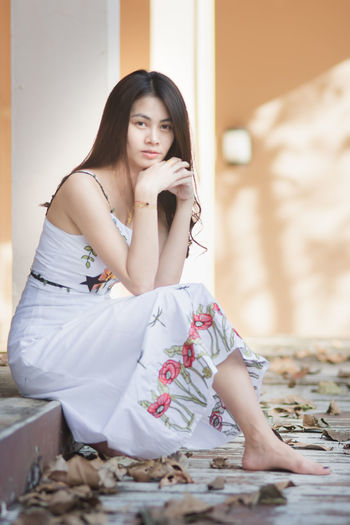 One Person Sitting Young Adult Real People Young Women Lifestyles Front View Casual Clothing Indoors  Full Length Leisure Activity Looking Looking Away Long Hair Hairstyle Beauty Women Hair Beautiful Woman Contemplation