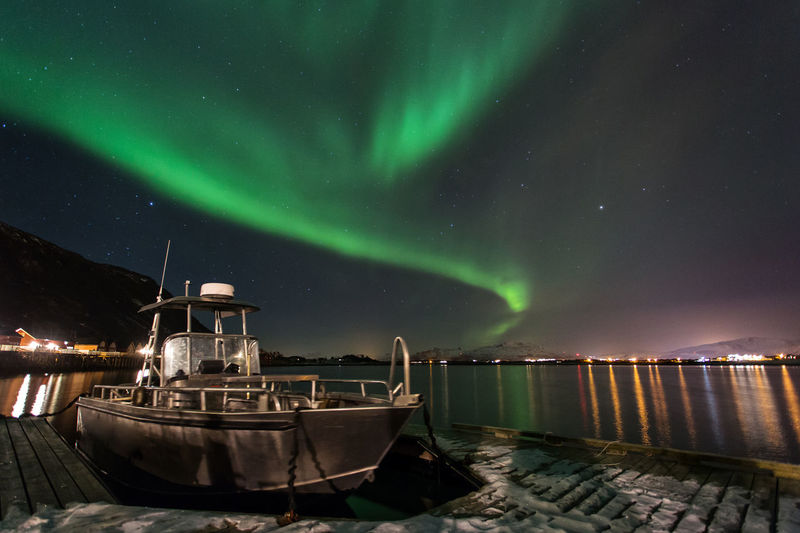 Boat moored at harbor at night