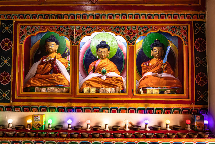 View of buddha statues in illuminated temple