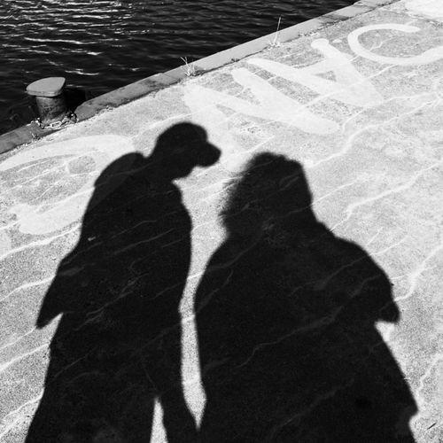 Shadow of couple on street