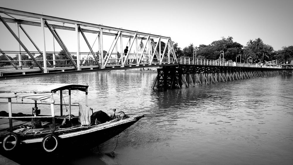 The boat alone Bridge - Man Made Structure Water Transportation River Sky Nautical Vessel Outdoors Moored City Day No People Hoogly Bhagirathi Place Of Worship Ganges Howrah Kolkata Travel Boat Black And White Vintge Dakhsineswar