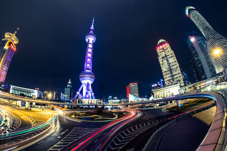 Nightphotography Architecture Blurred Motion Building Exterior Built Structure City Cityscape High Street Illuminated Light Trail Long Exposure Modern Motion Night No People Outdoors Pudong Road Sky Skyscraper Speed Transportation Travel Destinations