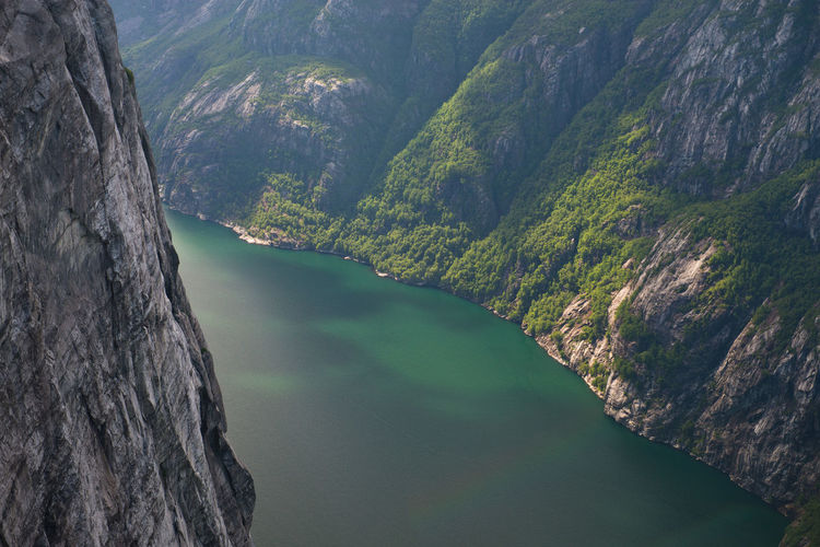 The beautiful turquoise coloured Lysefjord around Kjerag, near Lysebotn in Norway. Norway Travel Adventure Beauty In Nature Fjord Hike Hikingadventures Idyllic Landscape Mountain Mountain Range Nature No People Outdoors Remote River Rock Scenics Scenics - Nature Tranquil Scene Tranquility Travel Destinations Vertigo Water