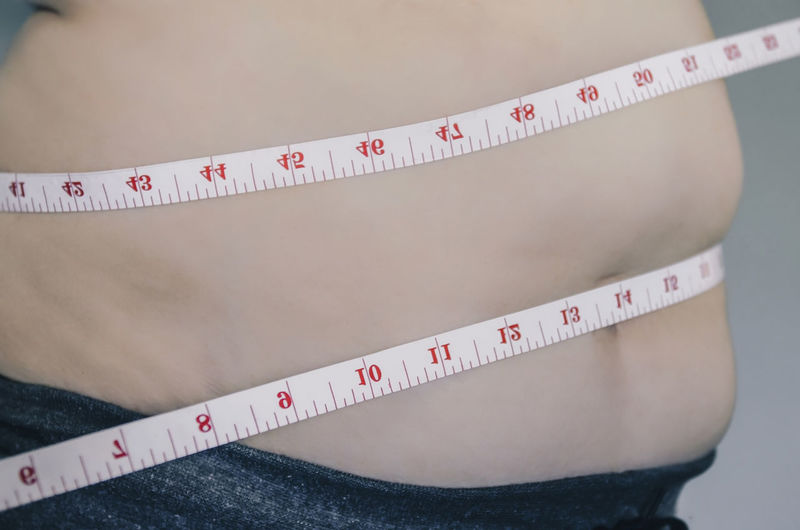 Close-up of human body and fat body, Fat body part of paunch or belly, Overweight of people or excess weight with measuring tape. Body & Fitness Diet Diet & Fitness Heavy Measuring Measuring Tape Obesity Overweighted Belly Body Conscious Body Part Dieting Fat Father Human Human Body Part Measurement Measuring Overweight person Tape Tape Measure Weight Weights 10