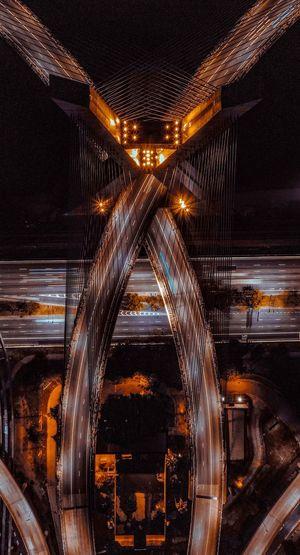 High angle view of illuminated bridge in city at night