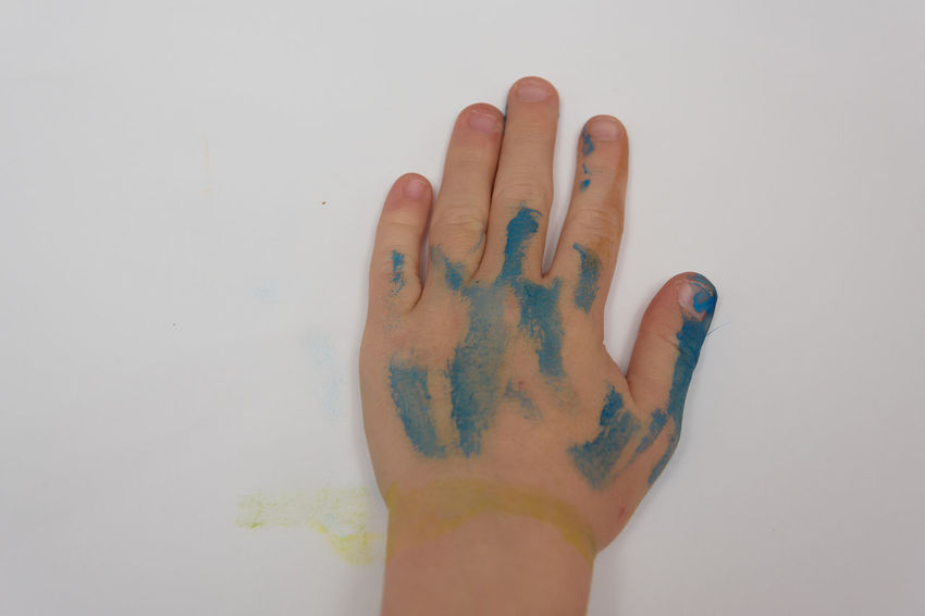 child painting their own hand during a art and craft activity Art And Craft Fun Kids Activity Art Art Activity Art And Nature Blue Child Childhood Close-up Craft Day Fingers Human Body Part Human Hand Indoors  One Person Paintbrush Painting Painting Hand People