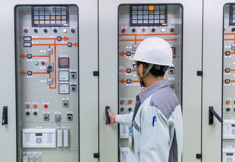 Engineer opening door of electric meter