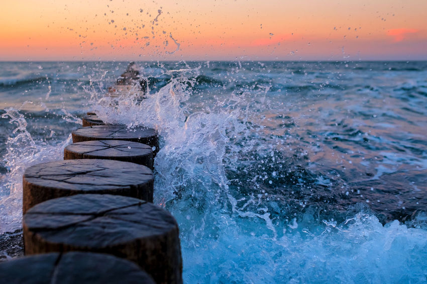 Baltic Sea Contemplation Copy Space Freedom Atmospheric Mood Beauty In Nature Breaking Dusk Groyne Hitting Horizon Over Water Idyllic Motion Nature No People Non-urban Scene Outdoors Power Power In Nature Relaxation Scenics - Nature Sea Splashing Sunset Wave
