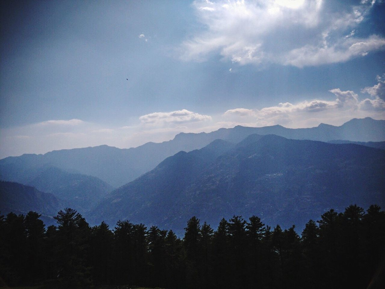 mountain, nature, beauty in nature, landscape, tranquility, sky, tranquil scene, scenics, tree, silhouette, forest, no people, outdoors, day, mountain range, freshness, range
