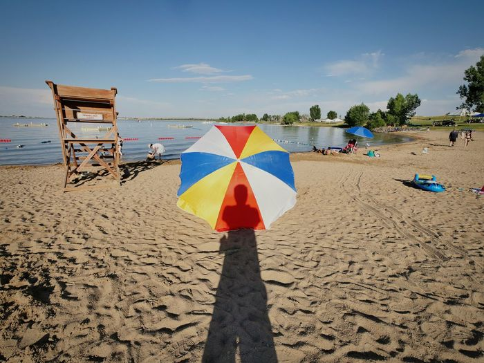 That's Me Enjoying Life Summer Summertime Reservoir Beach Photography Beach Umbrella Sand Shadow Water And Sky Showcase July Colour Of Life Eyeemphoto
