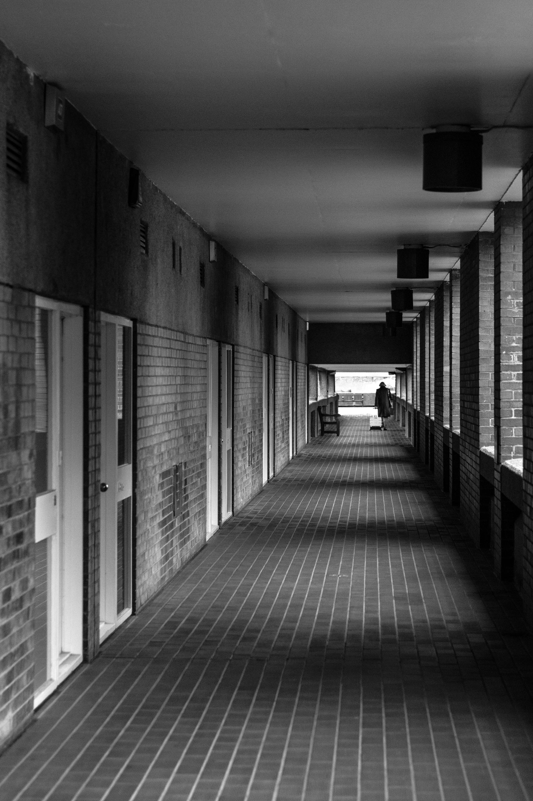 architecture, built structure, the way forward, direction, arcade, corridor, building, ceiling, indoors, illuminated, incidental people, flooring, diminishing perspective, architectural column, lighting equipment, empty, tile, footpath, day, subway, tiled floor, underpass, colonnade, long, underground walkway
