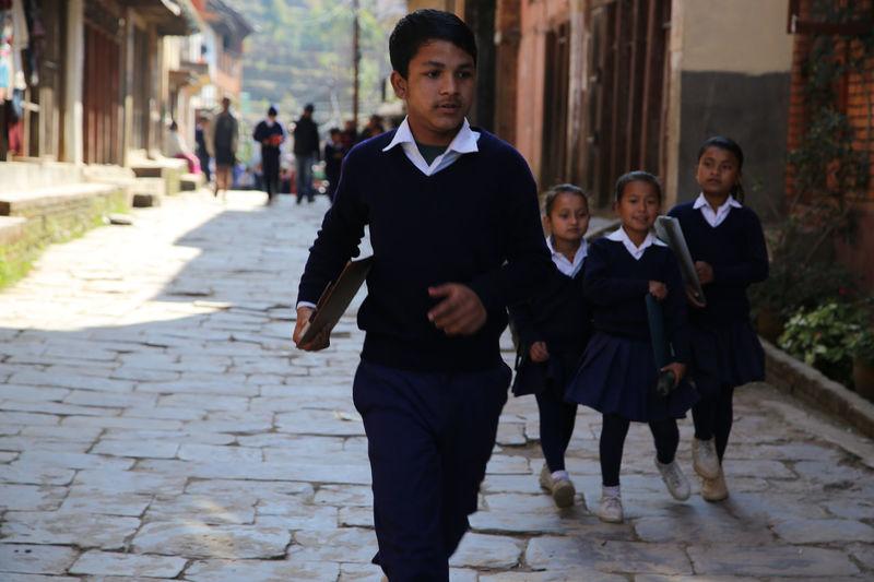 School Uniforms Around The World Bandipur Nepal Childhood Children Of The World Children Chidren On The Way Home Children On The Way To School In A Hurry  Boy Running