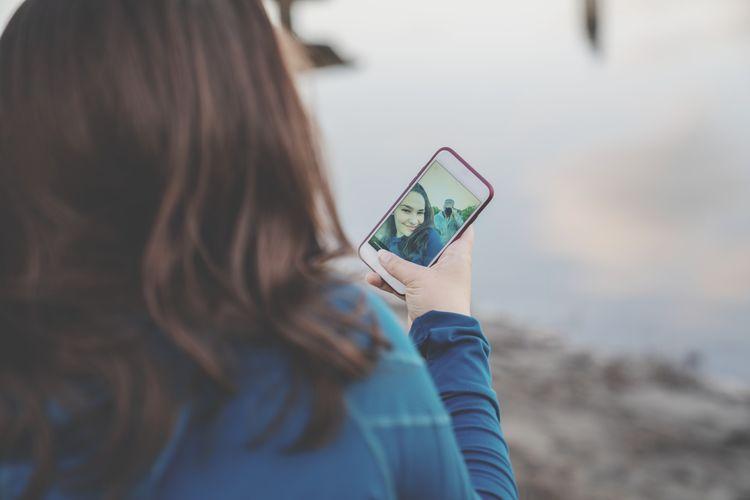 Girl taking selfie through mobile phone