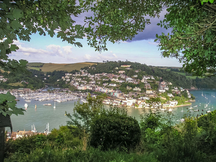 Looking across from Dartmouth to Kingswear on the opposite side of The River Dart. Architecture Beauty In Nature Building Exterior Built Structure Dartmouth Day Grass Green Color Growth High Angle View Kingswear Lake Landscape Mountain Mountain Range Nature Nautical Vessel No People Outdoors Plant Scenics Sky Tranquility Tree Water
