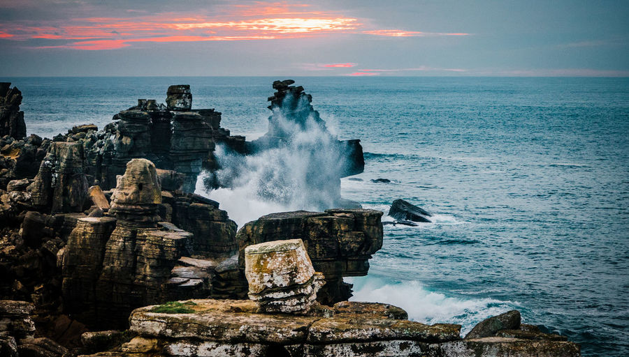 EyeEmNewHere Rock Formation Sunset_collection Wave Beauty In Nature Breaking Cloud - Sky Horizon Horizon Over Water Land Motion Nature No People Outdoors Power In Nature Rock Rock - Object Rock Formation Scenics - Nature Sea Sky Solid Sunset Water Wave
