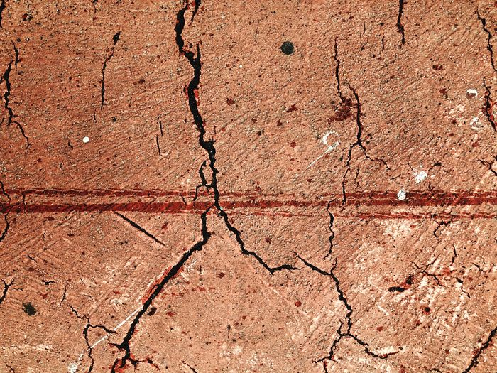 Abstract road cracks on the red road Street Red Rain Lines Crack Cracked Road Full Frame Backgrounds Textured  Pattern Cracked No People Damaged Close-up Weathered Dirt Day Outdoors Nature Old Rough Architecture