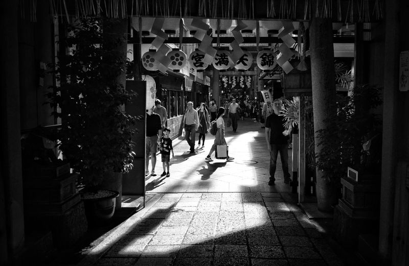 Passing By Passing By Walking Black And White Photography Streetphotography Shadows & Lights Kyoto Japan Photography Black And White Blackandwhite Architecture City Built Structure Sunlight Shadow Building Exterior Real People Street Day Incidental People The Way Forward People Lifestyles