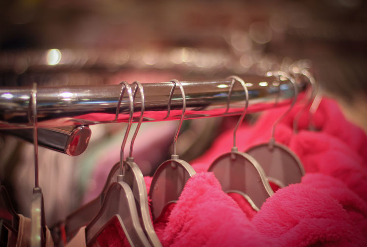 Close-up of warm clothing hanging on rack