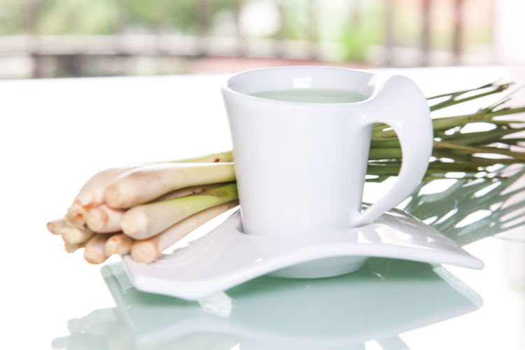 Lemon grass drink with a white cup view in close up with blur isolated background Lemon Grass Close-up Drink Drinking Glass Food Food And Drink Freshness Lemon Grass Tea No People White Cup