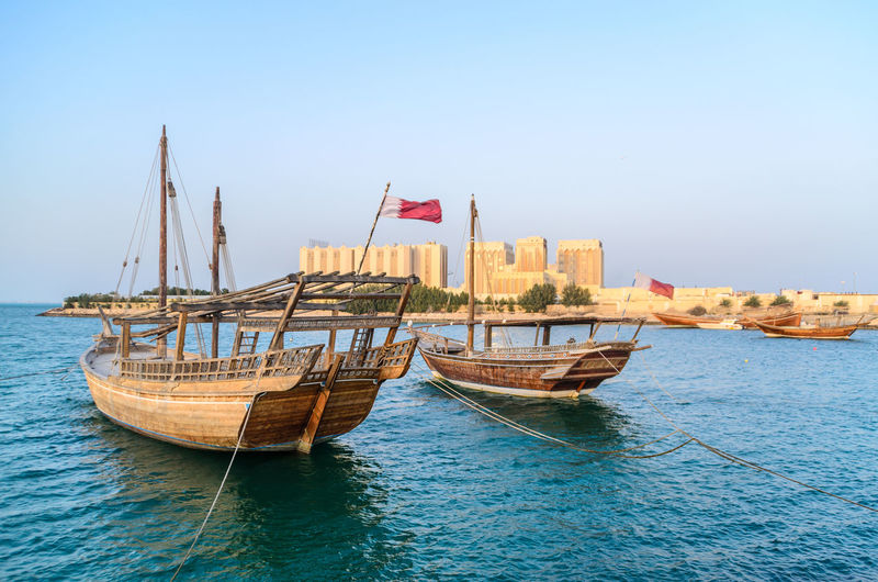 Doha Middle East Architecture Boat Clear Sky Day Dhow Flag Mode Of Transportation Moored Nature Nautical Vessel No People Outdoors Qatar Sailboat Sea Sky Transportation Water Waterfront Wooden