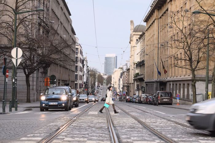 City Building Exterior Transportation Street Car City Street City Life Architecture Land Vehicle Built Structure Mode Of Transport Bare Tree Outdoors Road People Day One Person Adult Sky Adults Only (null)City Tram Brussels